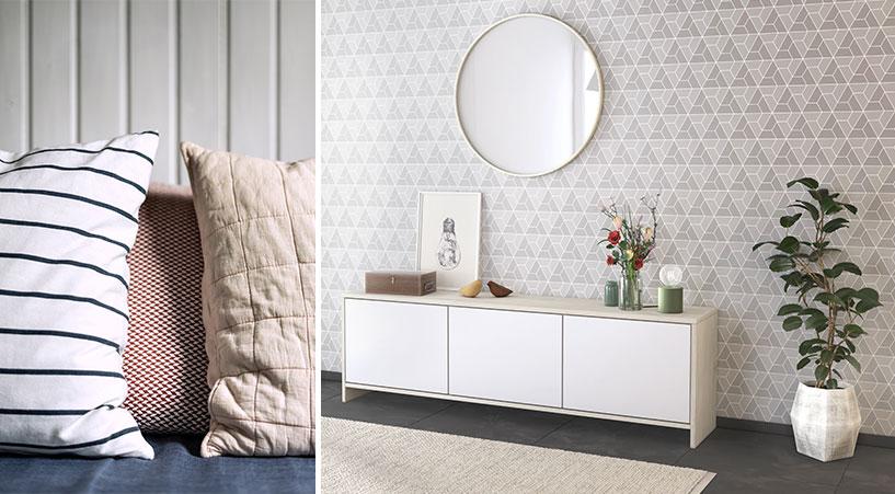 Kissen und Sideboard im Scandi Stil unter einem runden Spiegel