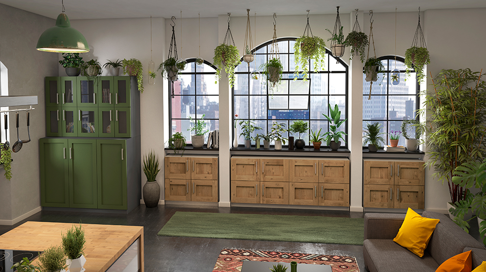 Grüne Anrichte in einer Küche mit vielen Pflanzen und Lowboards mit Massiv-Rahmenfront unter den Fenstern